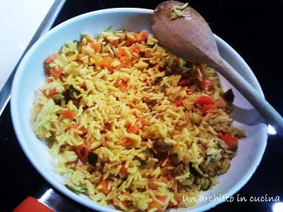 Peperoni ripieni al curry di verdure e riso basmati